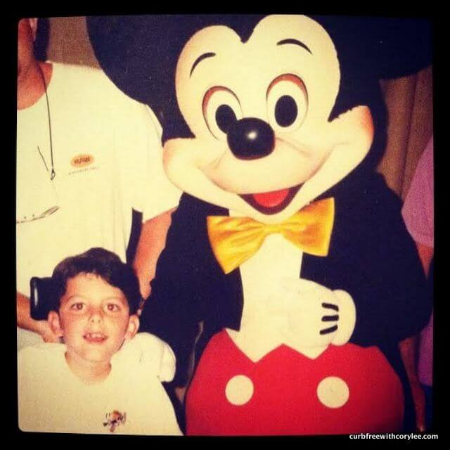 With Mickey Mouse at Disney World.